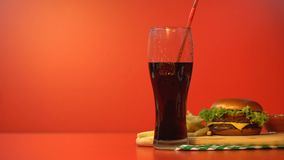 Person drinking soda with straw, fast food lunch, unhealthy high calorie meal stock video
