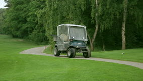 Person drives by with a golf car stock footage