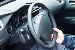 Person driving a car Stock Image