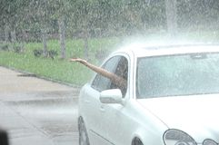 Person driving car in rain Royalty Free Stock Photos