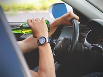 Person Driving and Drinking Stock Images