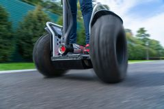 Person driving electric self-balancing scooter. Low angle view of person driving electric self-balancing personal transporter stock photography