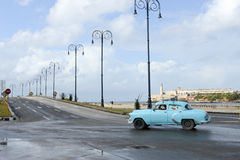 Person driving his vintage car at the Malecon in Havana. Havana, Cuba - 27 January 2016: Person driving his vintage car at the Malecon in Havana on Cuba Stock Images
