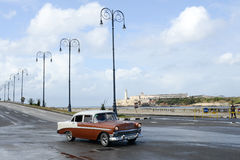 Person driving his vintage car at the Malecon in Havana Stock Image