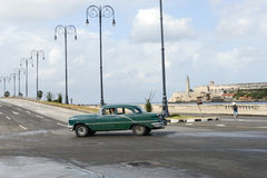 Person driving his vintage car at the Malecon in Havana. Havana, Cuba - 27 January 2016: Person driving his vintage car at the Malecon in Havana on Cuba Stock Image