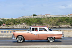 Person driving his vintage car at the Malecon in Havana Stock Photo