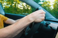 Person driving a new electric vehicle royalty free stock photo