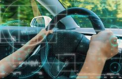 Person driving in a new high tech car stock photography