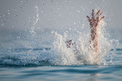 Person drowns in the water. Person drowns in the sea royalty free stock photography