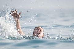 Person drowns in the water Royalty Free Stock Photo
