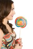 Person eating lollipop. Beautiful isolated person eating lollipop royalty free stock photos