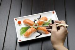 Person Eating Sushi Royalty Free Stock Photos