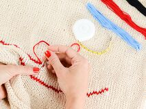 Person Embroidering a Beige Textile Royalty Free Stock Photo
