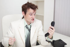 Person emotionally communicates with phone Royalty Free Stock Photography