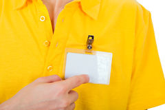 Person with Empty Badge. Person shows blank Badge on t-shirt closeup Stock Image