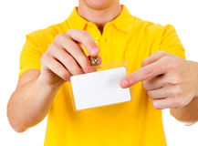 Person with Empty Badge. Person shows blank Badge on t-shirt closeup Stock Photo