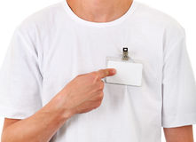 Person with Empty Badge. Person shows Blank Badge on the T-Shirt closeup Stock Image