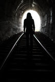 Person At End of Tunnel. Exit from darknes - Light at end of tunnel Royalty Free Stock Photography