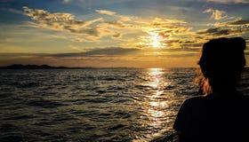 Enjoying the sunset at the coastline stock photo