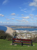Person enjoying view over Chesil Beach Stock Images
