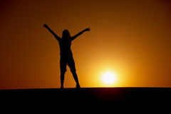 Person enjoys to the sun at sunset Royalty Free Stock Images