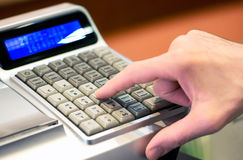 Person entering a sale on a cash register Royalty Free Stock Images