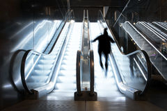 Person in escalator Royalty Free Stock Photos