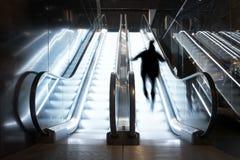 Person in escalator Royalty Free Stock Photos