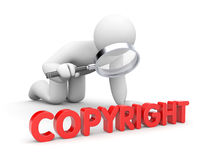 The person examines copyright sign Stock Photo