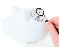 Person examines piggy bank Royalty Free Stock Photography