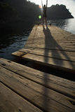 Person Exercising On Jetty Royalty Free Stock Photos