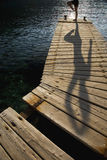 Person Exercising On Jetty Stock Images