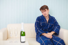 Person in expectation of woman with sparkling wine Royalty Free Stock Photo