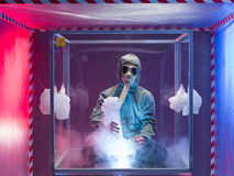 Person experimenting inside protection enclosure Royalty Free Stock Image