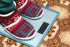 Person feet in new year shoes standing on weight scales.  Stock Photos