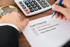 Person filling audit checklist form Royalty Free Stock Photo
