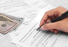 Person filling bankruptcy form. Business under loss applying for bankruptcy Stock Images