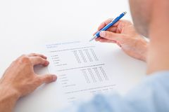 Person filling blank form Royalty Free Stock Images