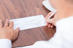 Person Filling Cheque Stock Photography