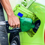 Person filling gas into a car station Stock Photography