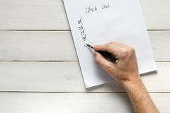 Person Filling Out Wish List, Top View. Memo Planning Strategy Process Ideas Concept stock photo