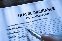 Person filling travel insurance application form Royalty Free Stock Photo