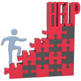 Person find HELP solution to problem. Person climbing puzzle to find help support solution to problem Royalty Free Stock Photos