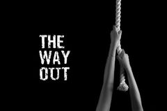 A person finds a way out of a difficult situation. The girl climbs on a white rope. Assistance provided in complex matters Royalty Free Stock Photo