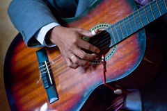 Person finger picking guitar. Close up of person in mariachi band finger picking guitar Stock Photo