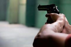 Person firing a hand gun
