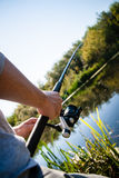 Person fishing in river royalty free stock photography