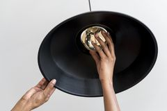 Person Fixing Pendant Lamp Stock Images