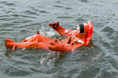 Person floating in survival suit stock images