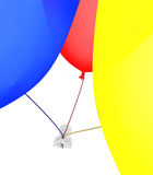 Person flying a balloons Royalty Free Stock Photos